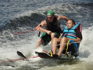 Felipe Ortez of Galveston (right) was one of about 100 participants in the 2010 Moody Gardens Adaptive Sports Festival.