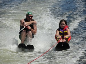 Reaghan Velasquez (right) of Manvel enjoys waterskiing for the first time Sept. 11 alongside volunteer Tim Thelen of Houston at the 20th annual Moody Gardens Adaptive Sports Festival. Reaghan, 8, is paralyzed from the calves down.