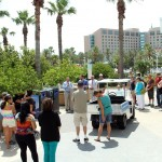 Moody Gardens General Manager explains how the solar-powered trash compactors/recycling stations and maintenance cart works